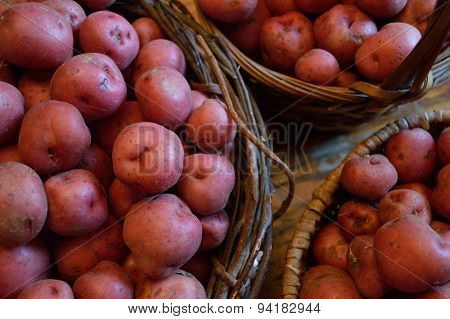 Red New Potatoes In A Baskets Together On Table