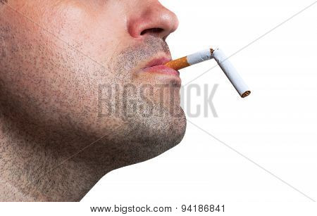 Man Holding A Broken Cigarette In His Mouth