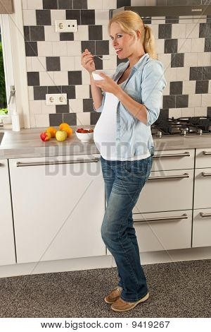 Pregnant Woman Having Lunch