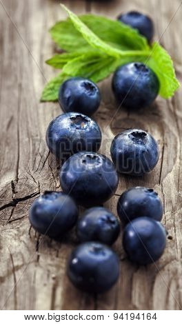 Blueberry on a wooden background,vertical, close-up