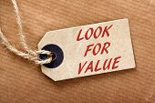 The phrase Look For Value in red text on a price or luggage tag with string on brown wrapping paper poster