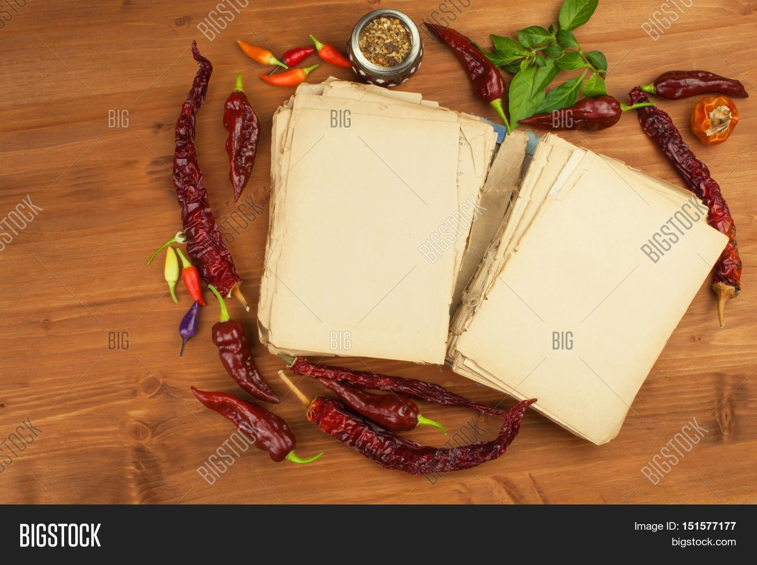 Cookbook chillies image photo free trial bigstock cookbook and chillies recipe for spicy food mexican cuisine food preparation according to forumfinder Choice Image