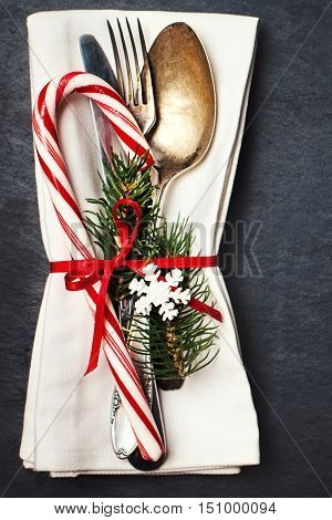 Christmas table place setting with decorations. Christmas holidays background