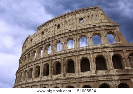 Coliseum fragment over beautiful cloudy sky Rome Italy