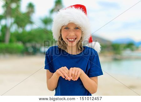 Happy Little Girl On The Beach. Christmas And New Year Vacations Concept.