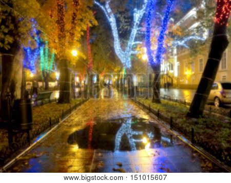 .blurred Bokeh Landscape City Streets In The Evening In Rainy Day. Blurred Background In Warm Dark C