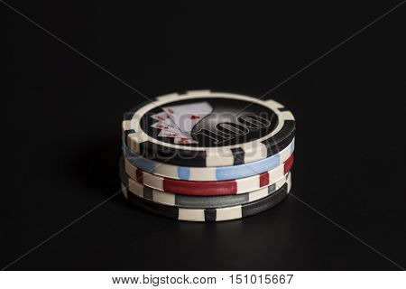 gambling chips on a black background .