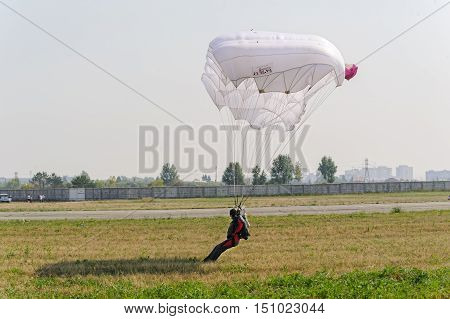 Tyumen, Russia - August 11, 2012: Air show On a visit at UTair in heliport Plehanovo. Paratrooper men lands in show program