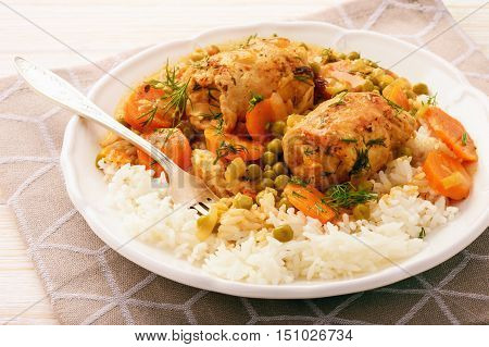 Roasted turkey roulades served with stewed vegetables and rice.