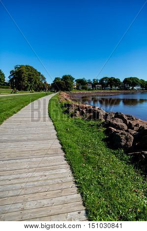 Wood Walkway by Rock Seawall in Canada poster