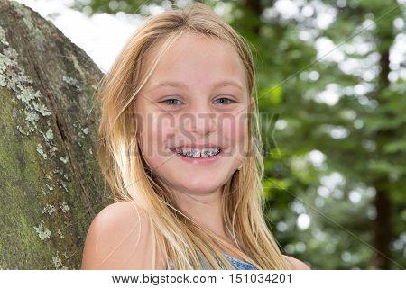 Portrait Of Smiling Teen Girl Showing Dental Braces