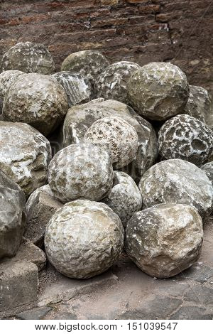 Ancient marble cannonballs in Castel Sant'Angelo in Rome Italy