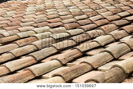 Old roof tiles on the roof of an old house