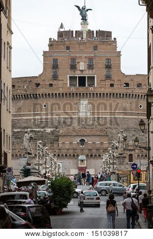 ROME, ITALY - JUNE 12, 2014: Rome - View of Castel Sant'Angelo Castle of the Holy Angel built by Hadrian in Rome along Tiber River