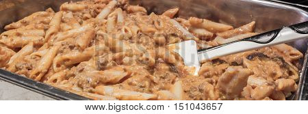 cook Italian pasta with ragu of meat