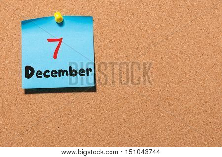 December 7th. Day 7 of month, Calendar on cork notice board. Winter time. Empty space for text.