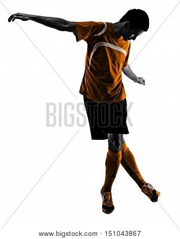 one brazilian soccer football player young man dribbling in silhouette studio isolated on white background