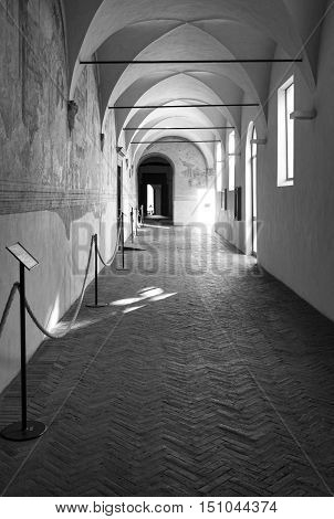 AREZZO, ITALY- AUGUST 16, 2016: old middle age colonnade of an ancient building in the historical city centre of Arezzo (Tuscany, Italy).