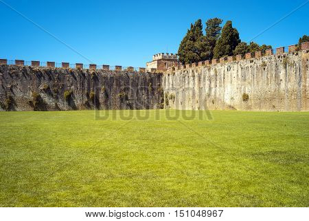 Detail of the defensive walls around the famous Campo dei Miracoli in Pisa (Tuscany, Italy), where are located the world famous leaning tower, cathedral and the baptistery.