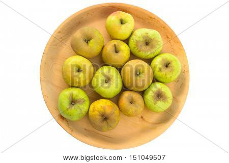 Wooden bowl full of imperfect looking organic apples with unconventionally raised method, no genetically modified organism techniques