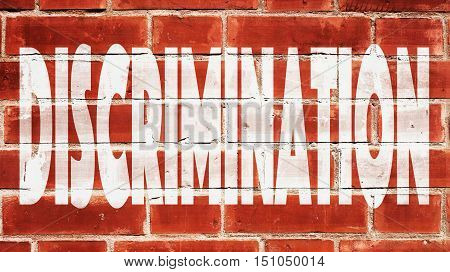 Discrimination Written On A Red Brick Wall.