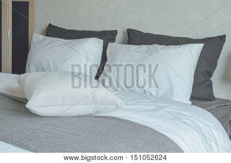 Clean bedding with king size bed in black and white color tone