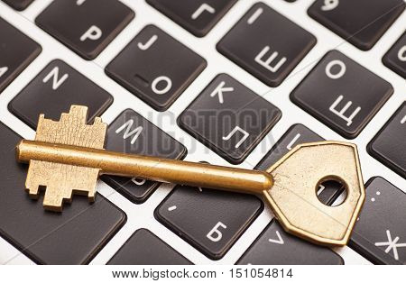 Computer with key. internet and network security concept.