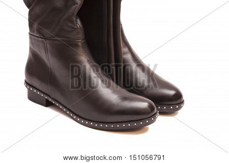 Female black high boots isolated on white background