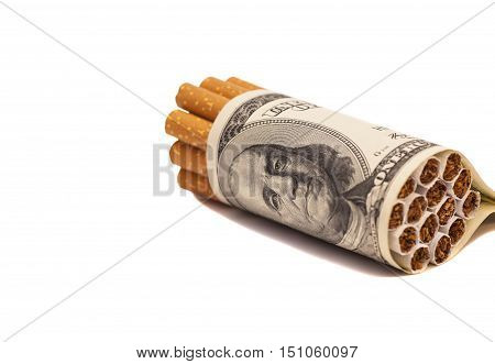 Cigarettes and money isolated on white background