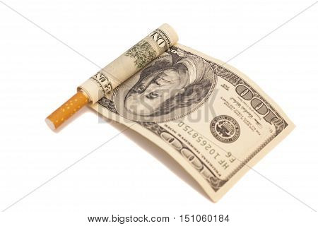 Cigarette and one hundred dollar bill on white background