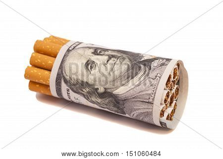 Cigarettes and money on a white background