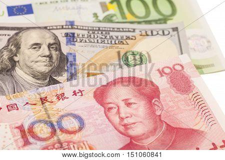 American dollars European euro and Chinese yuan bills