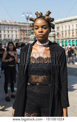 MILAN ITALY - SEPTEMBER 25 2016: Fashionable woman poses outside Stella Jean fashion show building during Milan Women Fashion Week SS17.