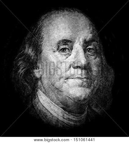 Portrait of Benjamin Franklin on black background
