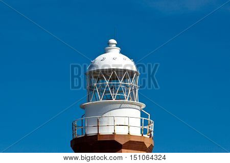 White lighthouse Light tower with blue sky.