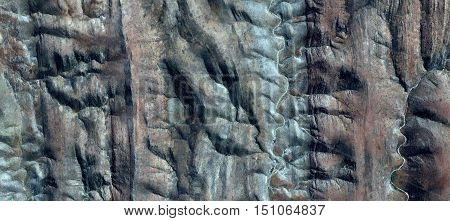 Turquoise river furrowing Easter Island Moai while watching the horizon, desert mirage of Africa from the air, belonging to Naturalism Photo Abstract of Munimara in parallel vertical lines,