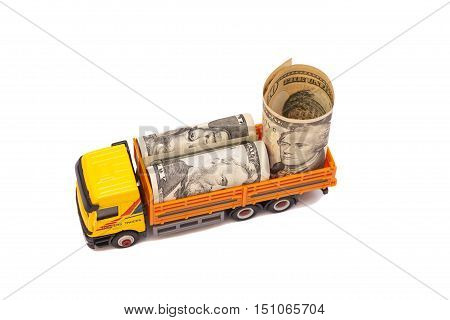 truck caries a roll of dollar bills isolated on white background