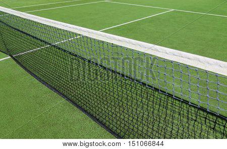Tennis court with green artificial grass detail