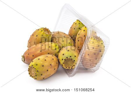 Box or punnet and spilled fresh prickly pears, opuntia, indian fig, ficus-indica fruit isolated on a white background