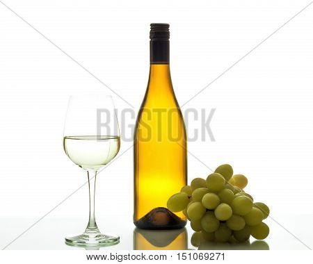 Wineglass with white wine and green grapes.