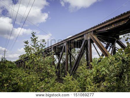 Span of train trestle on steel girders through Ontario Canada
