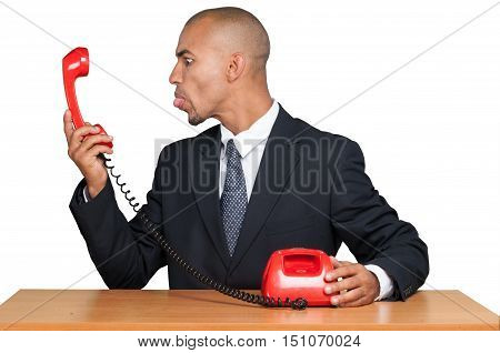 Portrait of a Businessman Sticking his Tongue out at a Phone