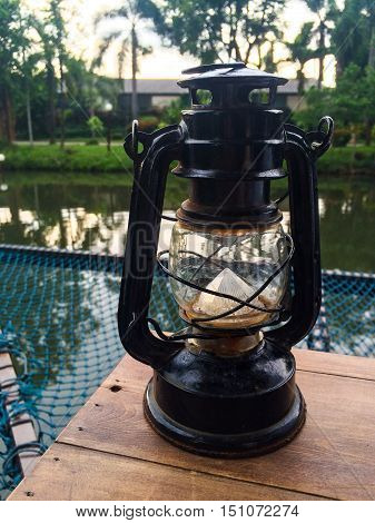 Hurricane lamp storm lantern on wood ground