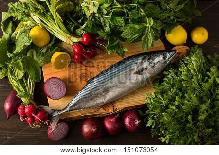 Bonito and Fresh Vegetables on Wooden Table