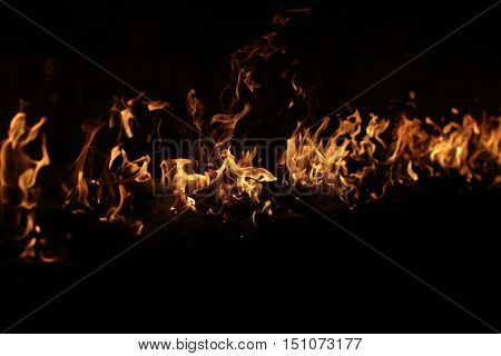 fire line on black. Shining flame on dark background. Flaming line made of orange fire