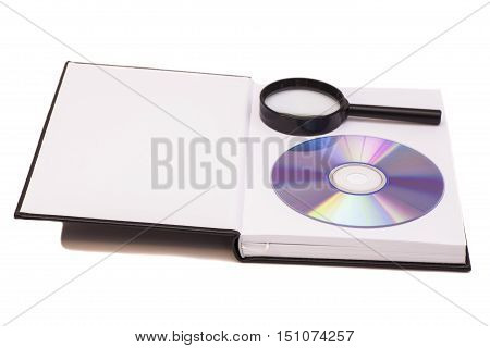 opened book with magnifying glass and compact disk CD