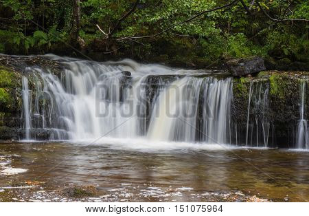 Ddwl Isaf waterfall (Lower Gushing Fall) on the Nedd Fechan River along the Elidir trail in South Wales UK