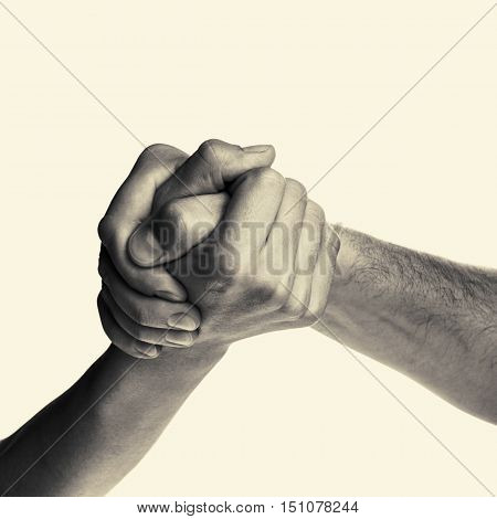 Struggle between the two rivals (arm wrestling). Image is black and white toned isolated.