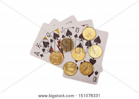 Royal flush. Playing cards end coins isolated on white background