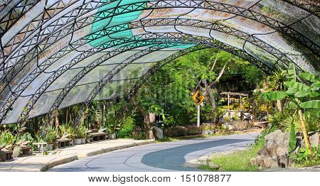 steel arch and mesh road canopy seen at a zoo south of Songkhla, Thailand